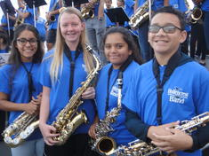Students hold their instruments